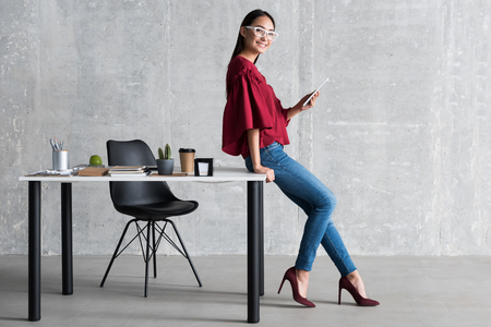 Cheerful woman enjoying her business work