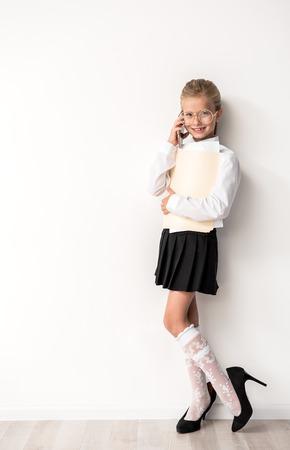 Positive female child is having communication on smartphone