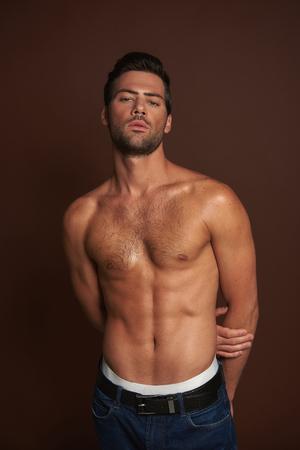 Sexual topless muscular man posing on camera
