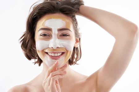 Photo pour Portrait of cheerful pretty female with face mask - image libre de droit