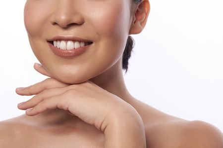 Photo for Lower part of the face of smiling woman touching her chin - Royalty Free Image