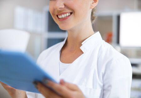 Foto de Cheerful therapist observing patient information stock photo - Imagen libre de derechos