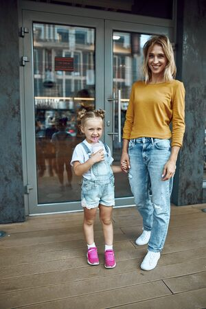 Photo for Mother and daughter standing outside the cafe stock photo - Royalty Free Image