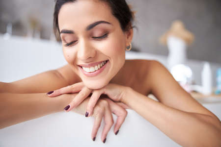 Photo for Girl enjoying free time and having bath - Royalty Free Image