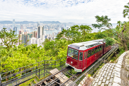 Photo for Victoria Peak Tram and Skyscraper buildings with Victoria Harbour, Victoria Peak, Hong Kong - Royalty Free Image