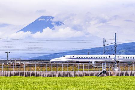 Photo pour High Speed Train passing Fuji Mountain Background in Summer, Fuji City, Shizuoka, Japan - image libre de droit