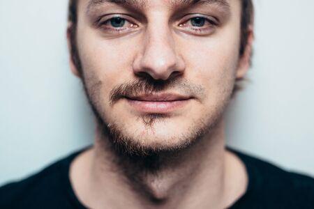 Photo pour A close portrait of a shaved man on one side only. - image libre de droit