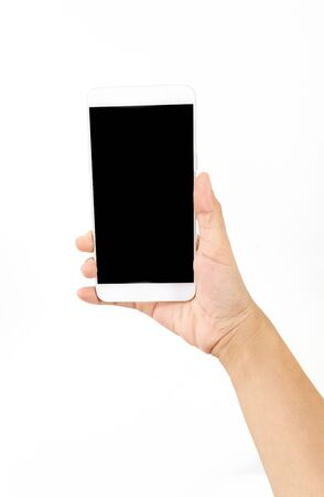 Photo pour Female hand holding a white cell phone with a black screen at an isolated background. - image libre de droit