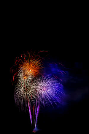Photo pour Beautiful colorful isolated firework display for celebration happy new year and merry christmas on black background - image libre de droit