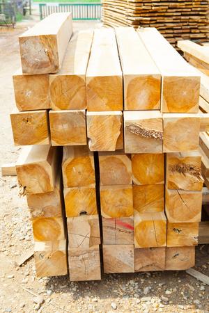 Stack of teak wood square in lumber yard. pile  Wooden