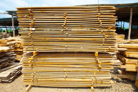 Stack of teak wood boards in lumber yard. pile  Wooden