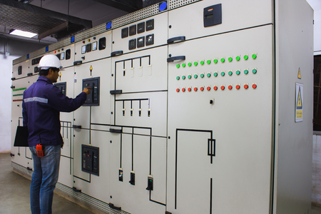 Photo pour Engineer checking and monitoring the electrical system in the control room - image libre de droit