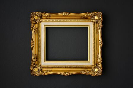Photo for gold vintage picture frame on black color wall background, copy space, funeral and mourning concept - Royalty Free Image
