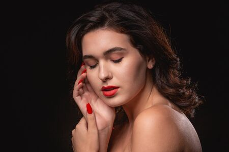 Photo for Beautiful woman with bright makeup posing isolated over black background. Image of young beautiful woman with red lips - Royalty Free Image