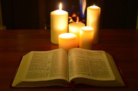 Photo pour Student studying by candlelite - image libre de droit