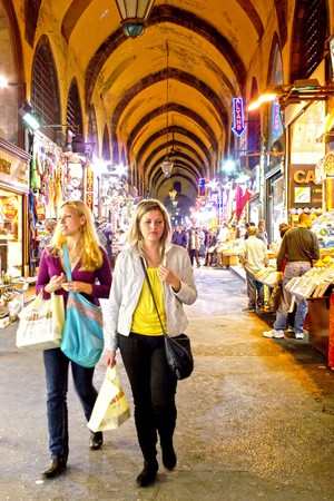 ISTANBUL - November 7, 2009: Two young girls in shopping at famous Egyptian Bazaar (Spice Market)