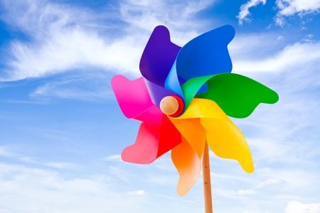 Photo pour Color pinwheel against summer sky - image libre de droit