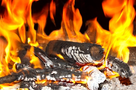 Burning open fireplace with fire, flame, wood and embers