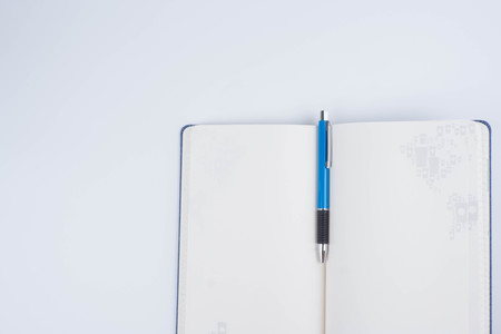 Top view Note Book and blue Pen on white background for Take note in Business Planning,job,study,