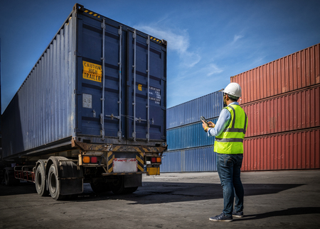 Photo for Foreman control loading Containers box to truck for Logistic Import Export Background, Business logistic concept, import and export concept. - Royalty Free Image