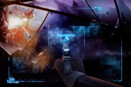 Photo pour Hand in gloves holding a pointing straight handgun. First person view hand in black leather gloves holding a futuristic fantasy neon pointing straight handgun with neon red, blue indicator panels. - image libre de droit