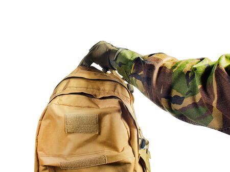Photo pour First person view isolated soldier hand in tactical gloves and camouflaged shirt holding olive bag on white background. - image libre de droit