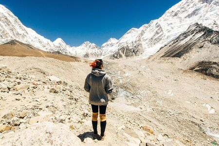 Photo for Landscape with girl, high mountains with snowy peaks, path, blue sky in Nepal. Travel. - Royalty Free Image