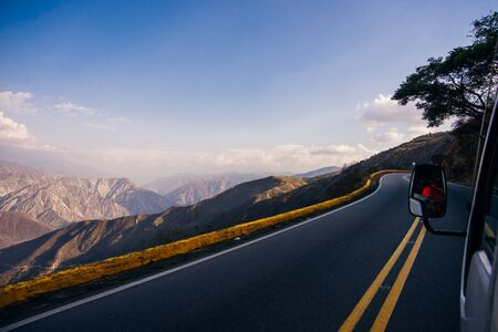 Photo pour curved road in mountains with cliff. - image libre de droit
