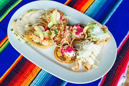 Mexican vegetarian tacos in a restaurant on a white plate