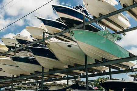 Photo for speed motor boats are stapled in a garage system in the prestigious harbor in Miami. - Royalty Free Image