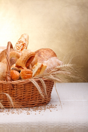 Variety of baked products in basket. Copy space above