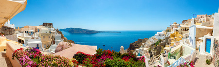 Panorama of colorful houses in Oia town, Santorini island