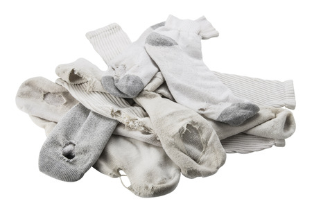 Photo pour Pile of old white socks with holes, isolated on white. - image libre de droit