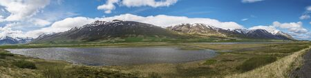 Panoramic view of Trollaskagi Peninsula, near Dalvík, Iceland with some horses and agricultural land in the background