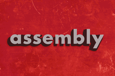 assembly vector word on red concrete wall