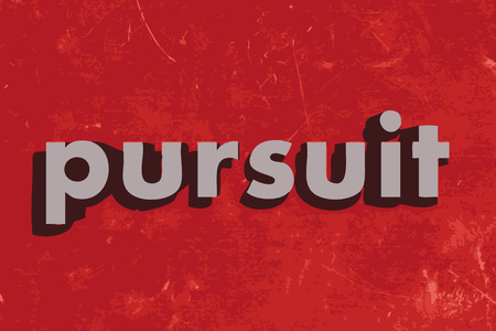 pursuit vector word on red concrete wall