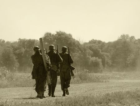 World War II era soldiers on a country road