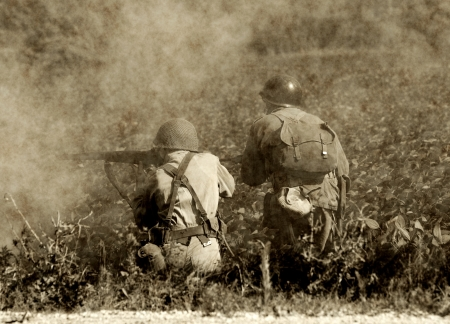 Two soldiers ina  World War II era battlefield
