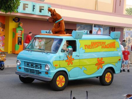 Orlando, Florida - January 14, 2007: Mystery machine van parades with Scooby Doo characters at Universal Studios Orlando. Crowds enjoy the company of various Nickelodeon and Universal Studios characters
