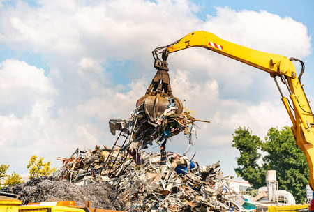 Photo for Close-up of a crane for recycling metallic waste on scrapyard - Royalty Free Image
