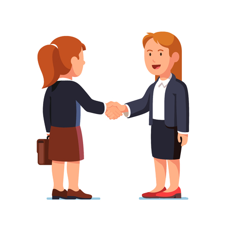 Two standing business woman shaking hands firmly