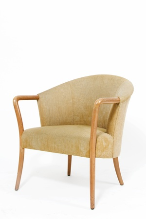 Contemporary light brown armchair on white background