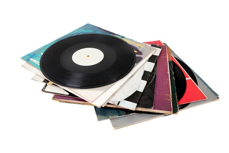 Pile of old vinyl records isolated on white