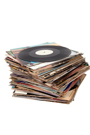 Pile of old vinyl records on white background