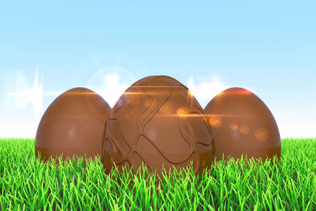 3 Easter eggs made of chocolate on the meadow