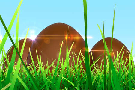 3 Easter eggs made of chocolate in grass