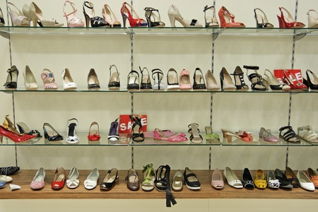 Counter with female shoes in shoe shop
