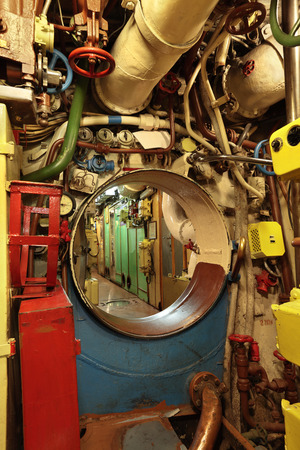 The interior of the old submarine, the passage between the compartments