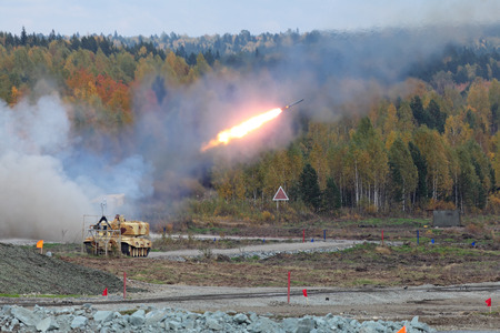 NIZHNY TAGIL, RUSSIA - SEP 25, 2013: The international exhibition of armament, military equipment and ammunition RUSSIA ARMS EXPO (RAE-2013). Volley russian Heavy Flame Thrower System, multiple rocket launcher TOS-1