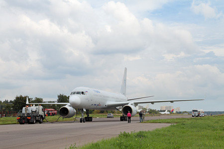 ZHUKOVSKY, RUSSIA - AUG 29, 2013: Preparation for flight Tupolev Tu-204 - twin-engined medium-range jet airliner at the International Aviation and Space salon MAKS-2013